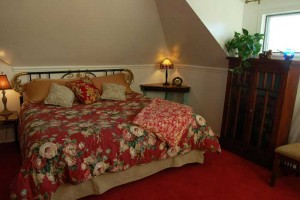king sized bed with floral throw
